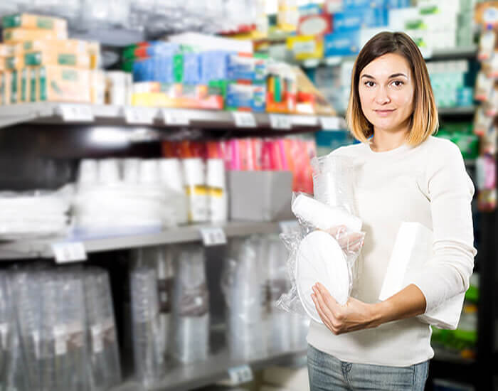 Woman Buying Disposable Plates and Cups