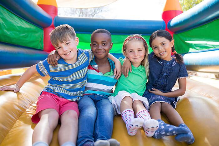 Friends Sitting on a Bouncy Castle