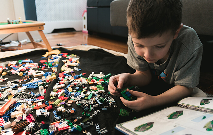 Kid Playing with Lego
