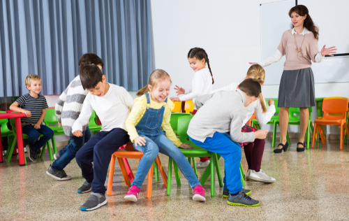 Happy kids playing Musical Chairs