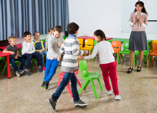 Children in exciting Musical Chairs game