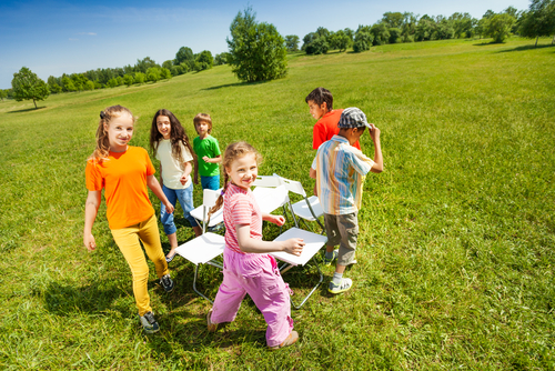 Children playing Musical Chairs outdoors