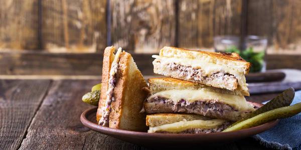 Homemade tuna melt sandwich on rural table, selective focus