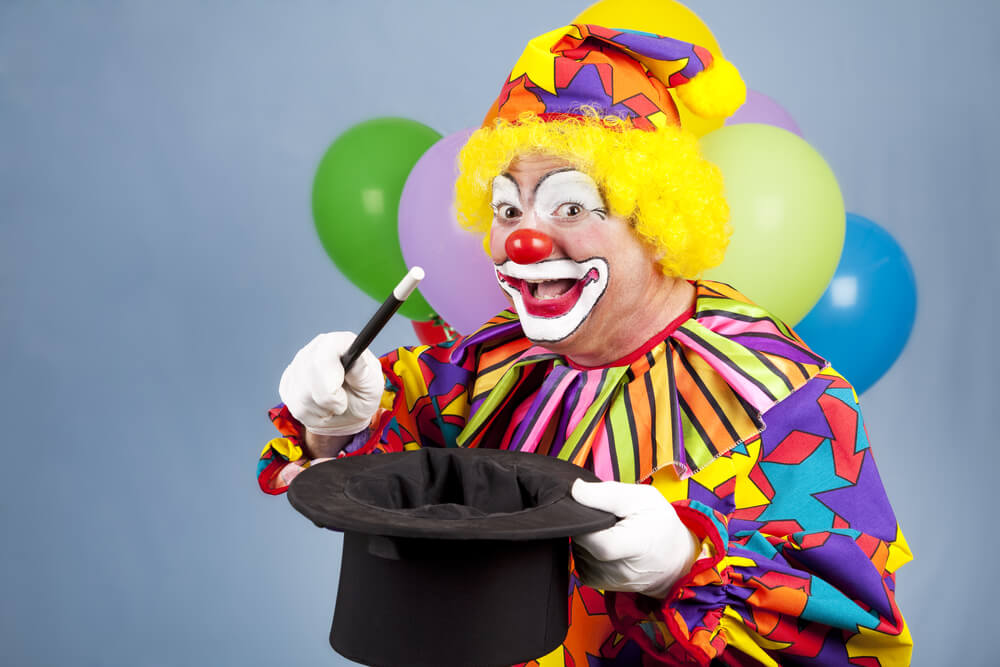 clown-doing-a-magic-trick-with-a-hat