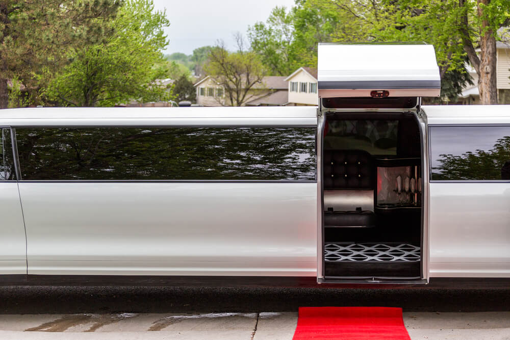 party buses or limos - entrance to a white stretch limo