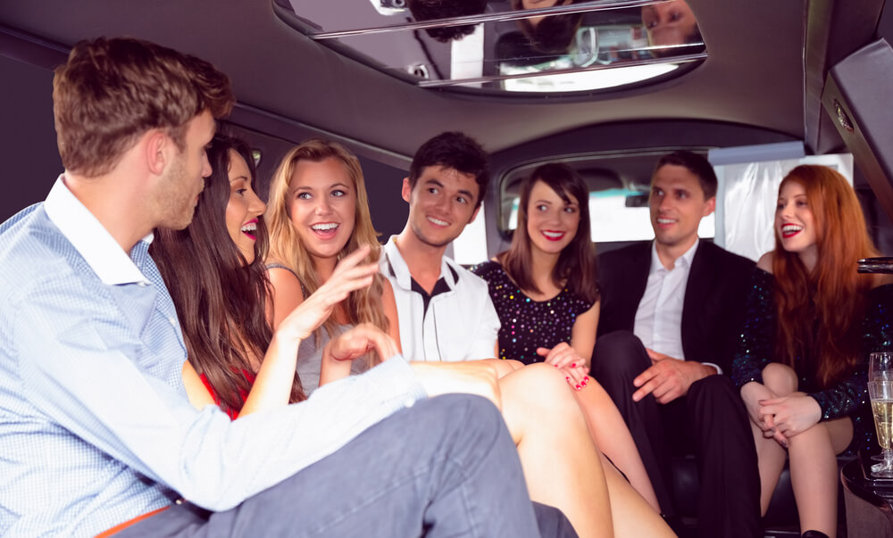 party buses or limos - group of friends inside a limo