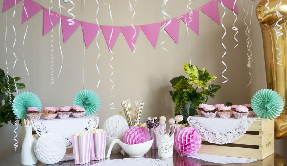 pink and aquamarine party decorations at a white living room
