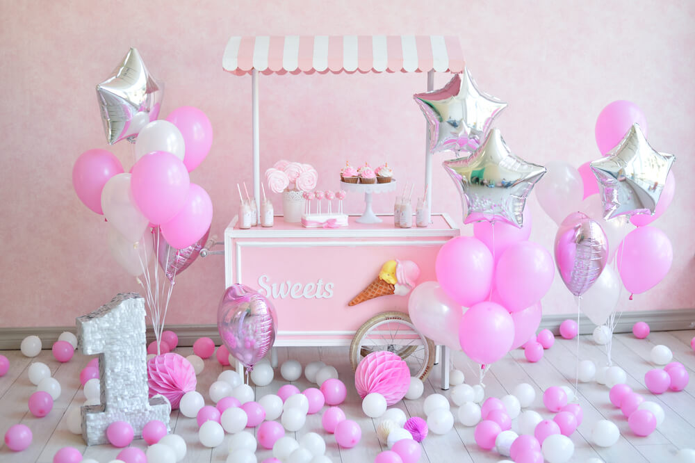 white, pink, and silver balloon decor at a girly party setting